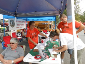 Donors wearing their favorite CBC t-shirts sign-up for prizes at Darke County Fair T-Shirt Day.