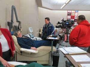Bert Jones, CBC's second-ranked blood donor, made his 515th lifetime blood donation with a news crew looking on.