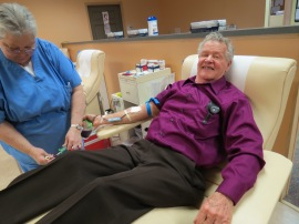 Richard Lipscomb makes his 246th lifetime blood donation.