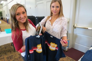 Nicole Devereux, a Gamma Phi from Chicago with sorority sister Meg Czerwonka from Ann Arbor, Michigan show off their '50 Years of Saving Lives' t-shirts.