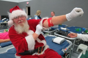 Santa Claus Jim Goettmoeller made his 43rd lifetime donation - and handed out candy canes - at the Sacred Heart Church blood drive.