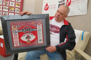 West Milton, OH blood donor Tom Warner gifted memorabilia from the 2002 OSU National Championship Fiest Bowl game for a Community Blood Center donor drawing.
