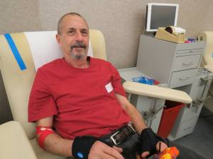 Kevin Fred donates his 100th lifetime donation.