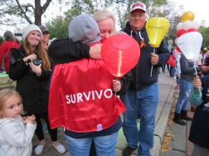 Leukemia survivor Robyn Davis embraces her mother after Survivor's Parade at Light The Night.
