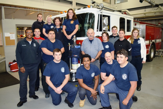 Sinclair Fire Science students with trophy