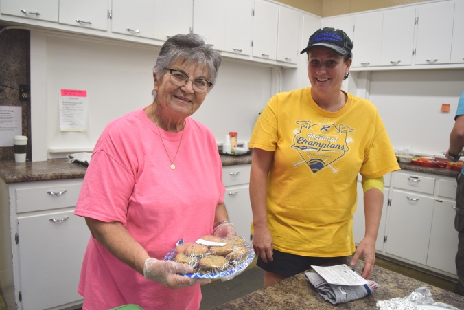 Volunteer Carol Dunkel, granddaughter Amy Spradlin